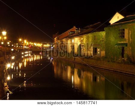 Reflection of the Old Warehouse and the Lighted up Street Lamp on Otaru Canal, Hokkaido, Japan