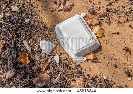 Garbage and foam litter on beach beach pollution environment.