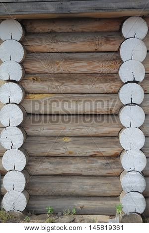 Wall of country wooden house. Construction's details of the log house.