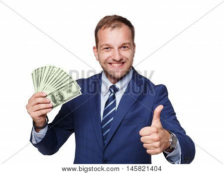 Portrait of a good-looking man showing money dollars fan against white background. Businessman with pack of american currency shows thumb up. Business and finance success, easy loan lots of cash.