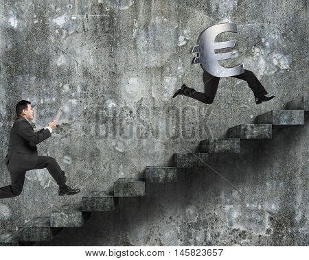 Man Running After Euro Money Symbol