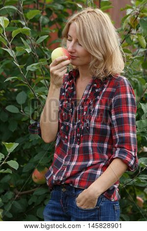 Woman Inhales Aroma Of An Apple