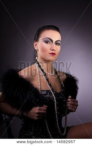 woman in fur boa with pearl beads retro syle
