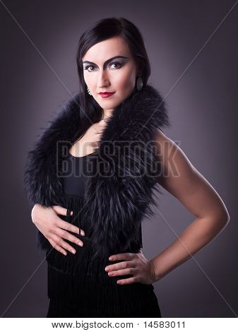woman in fur boa portrait - retro style make-up