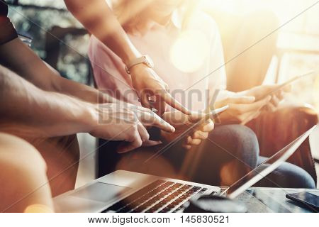 Young Coworkers Team Analyze Meeting Report Electronic Gadgets.Businessmans Startup Online Marketing Project.Creative People Making Great Work Decisions Office.Tablet Laptop Closeup Blurred Background