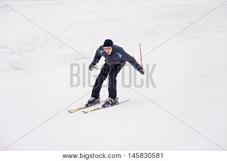 Young skier skiing in a Austrian mountain resort wintertime