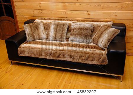 Black leather sofa with pillows and luxurious cover