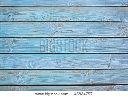 Old wooden fence. wood palisade background. blue planks texture