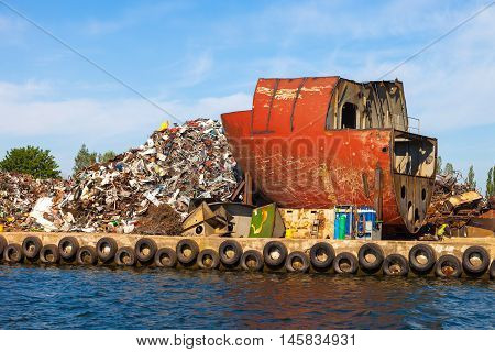 Dismantling the ship on scrap metal ready for recycling.
