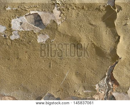 Old weathered crumbly plastered wall. Architectural details for texture or background