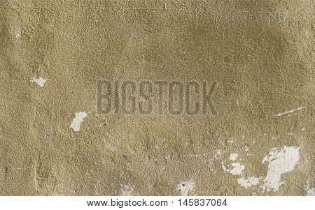 Beige plaster wall with uneven surface texture as a retro pattern layout