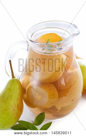 sweet pear compote in a decanter on a white background