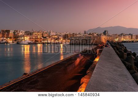 Harbor and Old Town of Heraklion, Crete, Greece in the sunset. Venetian fortress