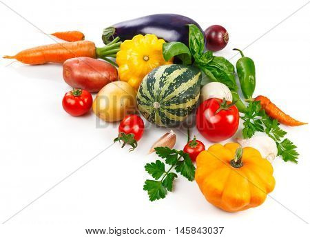 Fresh vegetables with green leaves and herbs. Isolated on white background