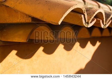 Weathered traditional terracotta roof of a Mediterranean house. Textured effect background.