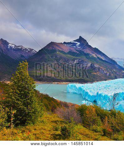 Sunny summer day in February. Los Glaciares National Park in Argentina. Colossal Perito Moreno glacier in Lake Argentino.