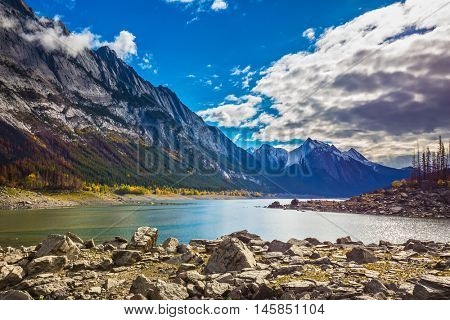 Autumn in Jasper National Park, Canada. Stony shore shoaled Medicine Lake
