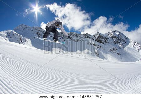 Snowboarder jumping on mountains. Extreme sport.