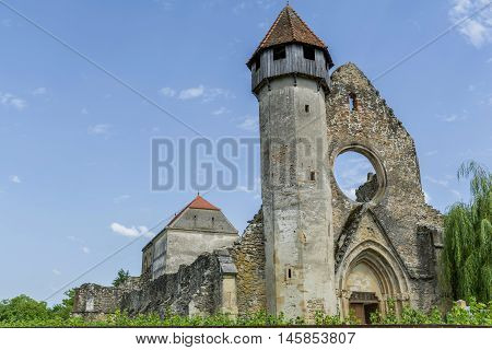 Ruins of medieval cistercian abbey in Transylvania, founded in 1202.Fromnt view.