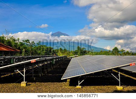 Bali, Indonesia - June 26, 2013: Solar PV with mountain in the background in Bali, Indonesia.