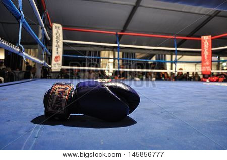 Sandbank, UK: September 9, 2011 - a boxing glove is on boxing ring after a match during Muay Thai Super Show, Windfest, Sandbank - Poole, UK.