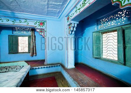 BUNDI, INDIA - FEB 17, 2015: Interior of bedroom in stone apartment building in Indian architectural style on February 17, 2015 in Rajasthan. Bundi is a city with 105000 inhabitants on the northwest India