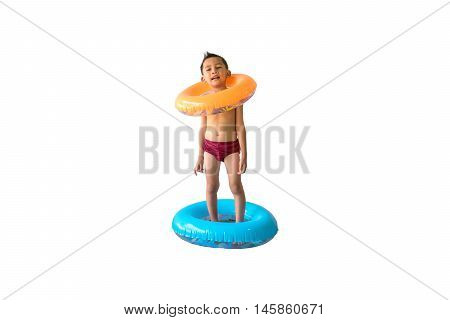 Cute Asian boy only in his underwear standing and holding a swim ring isolated on white background.