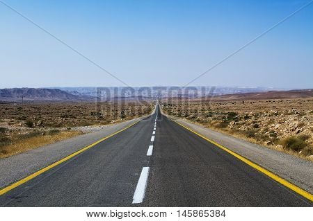 Beautiful road in the desert going beyond the horizon. Israel