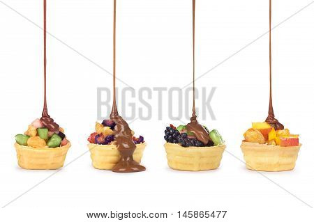 Chocolate pouring on fruit in waffle cup