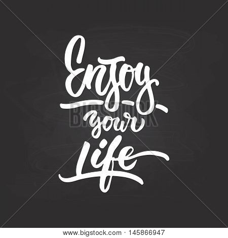 Enjoy your life- hand drawn lettering phrase isolated on the chalkboard background. Fun brush ink inscription for photo overlays greeting card or t-shirt print poster design.