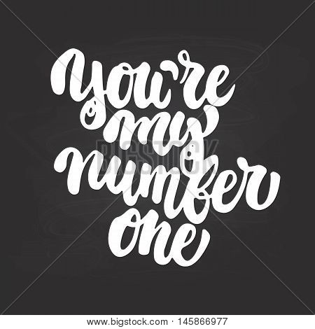 You're my number one- hand drawn lettering phrase isolated on the chalkboard background. Fun brush ink inscription for photo overlays greeting card or t-shirt print poster design.