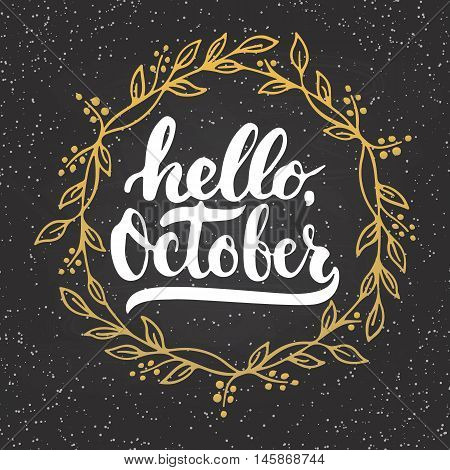 Hand drawn typography lettering phrase Hello, October with golden wreath on the chalkboard background. Fun brush inscription for photo overlays, greeting and invitation card or t-shirt print design.