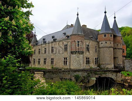 Old Belgium Castle Château de Spontin on Cloudy Sky background in Summer Day Outdoors