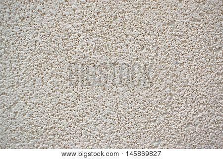 A closeup of a beige wall for graphic design texture