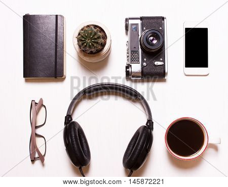 setcollage of men's women's accessories.Collage of men's women's accessories on white background. Phoneheadphonescamera vintage notebook glassescoffee. Creative concept creative human hipster designer photographer.Top viewView above