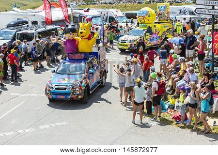 Col du Glandon France - July 23 2015: Haribo caravan during the passing of the Publicity Caravan on Col du Glandon in Alps during the stage 18 of Le Tour de France 2015. Haribo is the biggest manufacturer of gummy and jelly sweets in the world.