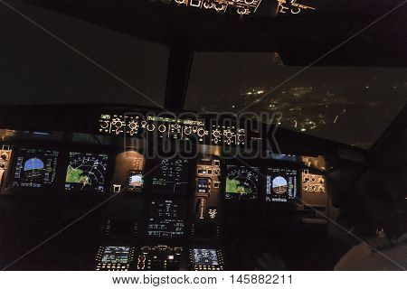 FRANKFURT GERMANY - OCT 10 2014: landing by night with a commercial aircraft A320 at the airport of Frankfurt Germany.