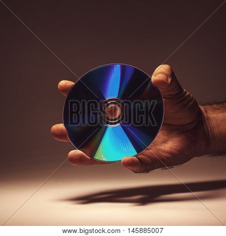 Compact Disk In A Hand