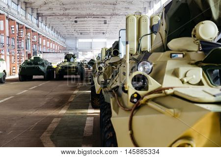 Armoured personnel carriers of different color on