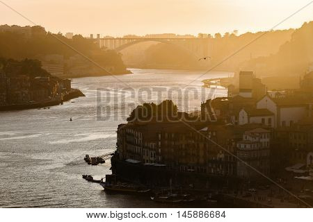 Sunset over the river douro in Porto.