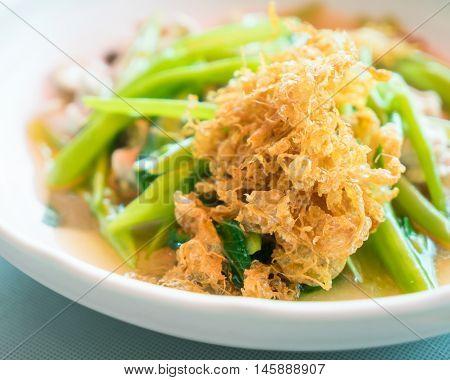 Thai Rad Nah stir fried noodle with gravy sauce, crispy egg.