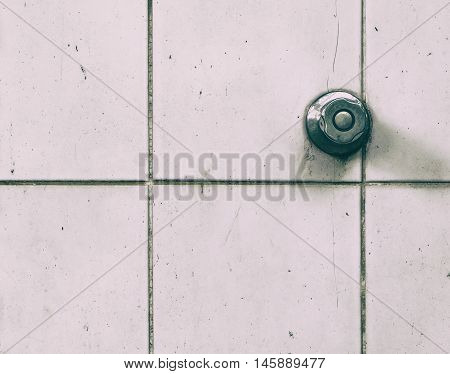 shower water tab knob on dirty toilet tiles wall vintage rustic tone.
