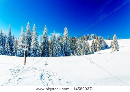 Beautiful mountain snowy landscape and turistic destination sign