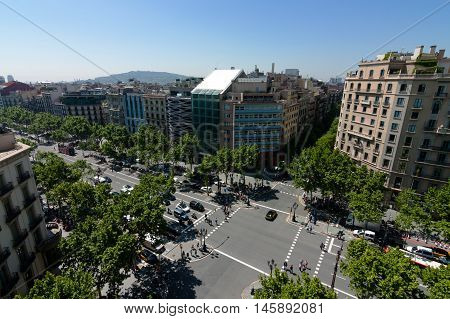 Wide crossroads in the center of Barcelona.