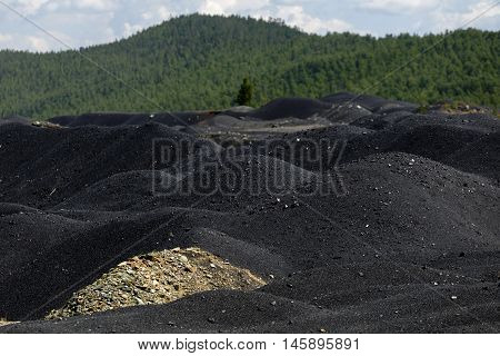The accumulation of slag after the establishment of the plant.