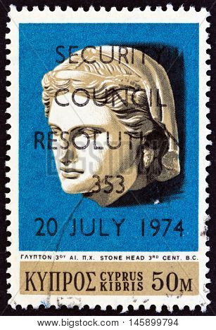CYPRUS - CIRCA 1974: A stamp printed in Cyprus shows Hellenistic Stone Head (3rd century B.C.) and U.N. Security Council Resolution 353 overprint, circa 1974.