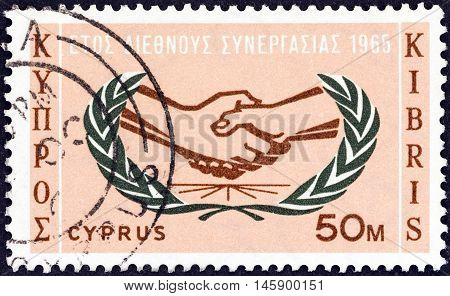 CYPRUS - CIRCA 1965: A stamp printed in Cyprus issued for the International Co-operation Year shows I.C.Y. Emblem, circa 1965.