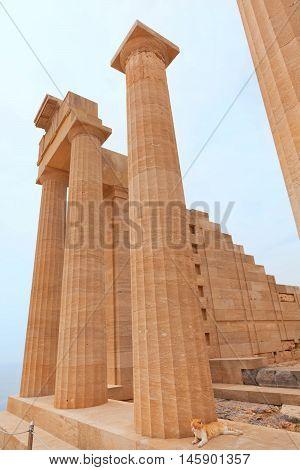 Ancient columns on Lindos island Greece. Vertical shot
