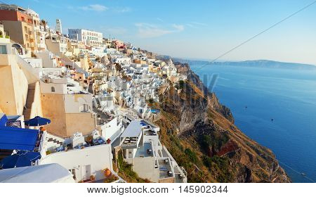 Cityscape panorama of Fira town Santorini in the late afternoon