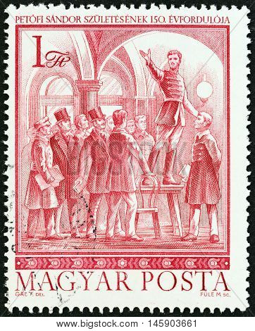 HUNGARY - CIRCA 1972: A stamp printed in Hungary issued for the 150th birth anniversary of Sandor Petofi (poet and patriot) shows Petofi making speech in Cafe Pilvax, circa 1972.